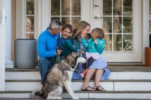 family on the porch with a dog