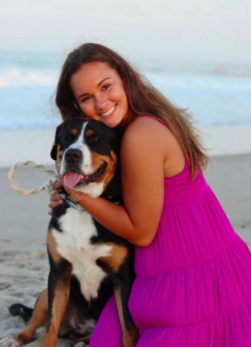 Girl with Pet dog on the beach