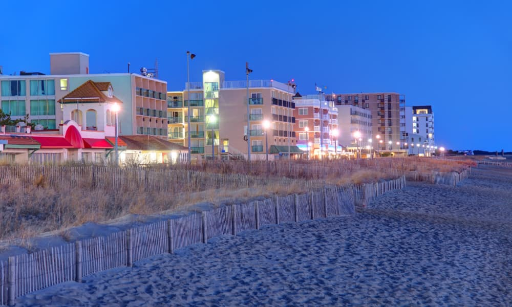 a view of rehoboth beach boardwalk at dusk