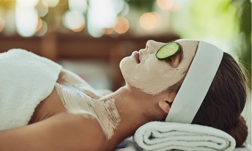 a woman receiving a face mask and cucumber treatment at a rehoboth beach spa